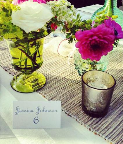 TKNotes Custom Tent Name Cards Tucked Between Colorful Flowers